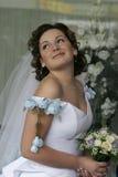 Braut mit einem Blumenstrauß Stockbilder