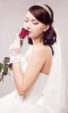 Braut mit einer Rose Stockfoto