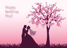 Braut und Bräutigam unter der Kirschblüte Stockfotografie