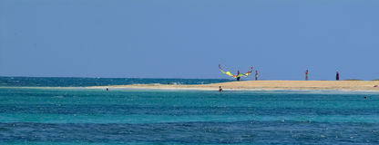 Brautiful blue bay ,Canvas Kite surfer on the beach Royalty Free Stock Photo