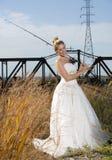 Brautschönheit mit der Fischerei Pole Lizenzfreie Stockfotos