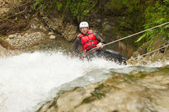 Brave Adult Man Rappelling A Waterfall Royalty Free Stock Image