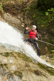 Brave Adult Man Rappelling A Waterfall Royalty Free Stock Photos