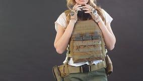 Female ranger posing isolated on black studio background