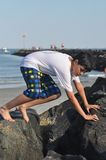 Brave Boy. A young boy is trying to explore a coast of Hampton Beach, New Hampshire Royalty Free Stock Image