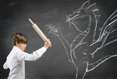 Brave boy fighting a dragon. Concept of courage with brave boy fighting a dragon royalty free stock images