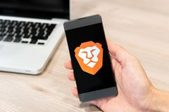 Brave Browser logo displayed on smartphone and computer laptop in background. Slovenia 13.02.2019 royalty free stock photo