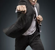 Brave businessman fighting againts challengers Stock Photo