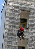 Brave climber training during rappelling Royalty Free Stock Images