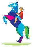 Brave cowboy tames a wild horse Stock Image