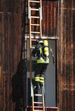 Brave firefighters with oxygen tank fire during an exercise held Stock Photos