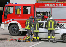 Brave firefighters relieve an injured after a road accident Royalty Free Stock Photography