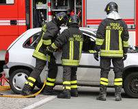 Brave firefighters relieve an injured after a road accident Stock Photo