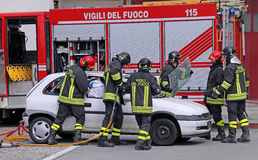 Brave firefighters relieve an injured after a road accident Royalty Free Stock Photos