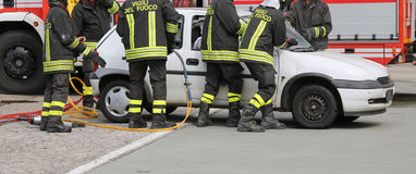 Brave firefighters during ROAD ACCIDENT Stock Image