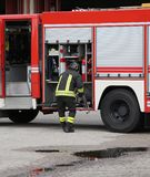 Brave firefighters and their fire truck Royalty Free Stock Images