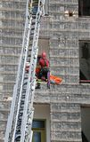 Brave Fireman during an exercise carries the stretcher with the Stock Image