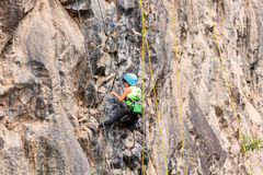 Brave Girl Climbing A Rock Wall Royalty Free Stock Photo