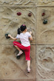 Brave Girl climbing on the wall. Brave Girl play climbing game Royalty Free Stock Photo