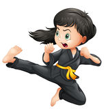A brave girl doing karate Royalty Free Stock Photo