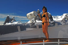 Brave Girl or Global Warming?. Despite sub zero conditions Macarena jumped out of the jacuzi to photograph Point Renard at the north end of the Lemaire Channel Royalty Free Stock Photography