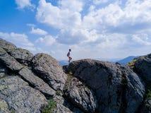 Brave girl running down the ridge stock photos