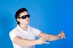 Brave guy in the studio against a blue background Royalty Free Stock Images