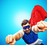 Brave heroe flying over the town Royalty Free Stock Photography