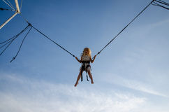 Brave kid jumping high up in skies Royalty Free Stock Image