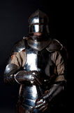Brave knight with his sword. Picture of noble knight in armour Stock Photo