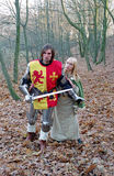 Brave knight and maid in forest Stock Photos