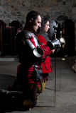 Brave Knights Praying in the Old Church Before the Battle Stock Photos