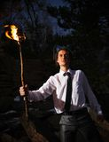 Brave leader. Image of brave man with burning stick in darkness stock image