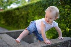 Brave little girl learning to climb Royalty Free Stock Photo