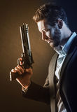 Brave man with dangerous weapon Stock Photos