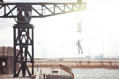 Brave man falling from the crane Royalty Free Stock Photography