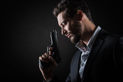 Brave man with handgun Royalty Free Stock Images