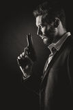 Brave man with handgun Royalty Free Stock Photography