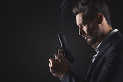Brave man with handgun Stock Photo