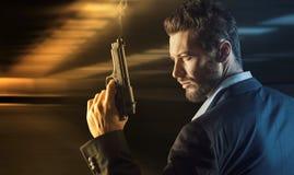 Brave man with handgun Royalty Free Stock Photo