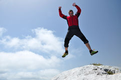Brave man jumping from a cliff Stock Images