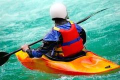 Brave man. Rides down a wild river kayaking Royalty Free Stock Photography