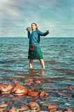 Brave man with sword in scottish costume Stock Photography