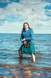 Brave man with sword in scottish costume Royalty Free Stock Photos