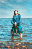 Brave man with sword in scottish costume Stock Image