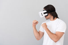 Brave man using virtual reality device royalty free stock photo
