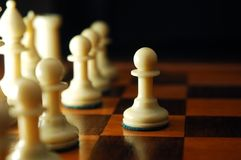 Brave pawn. Chess pawn going forward to the attack Royalty Free Stock Photography