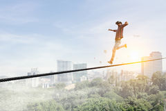 Brave and risky guy. Mixed media Royalty Free Stock Image