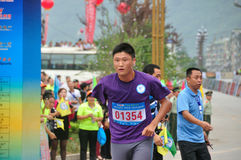 Brave runner of disability. Brave disability runner in the race.Half international marathon in fushui county in yunnan province in China, time: on September 25 Stock Photography