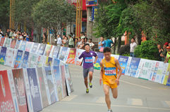 Brave runner of disability. Brave disability runner in the race.Half international marathon in fushui county in yunnan province in China, time: on September 25 Stock Image